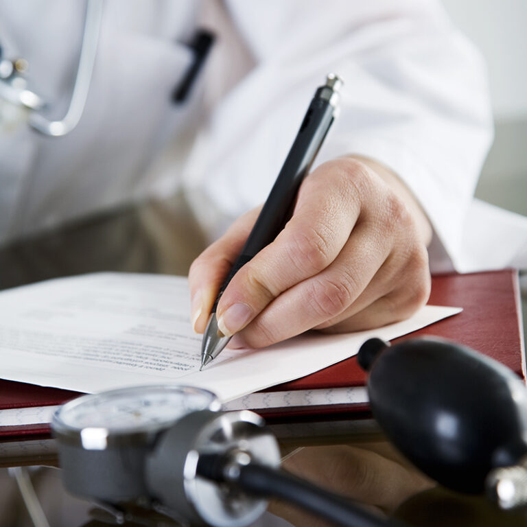 Image of a doctor writing a prescription